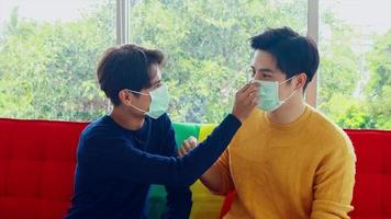Lgbt couples wear masks with each other video