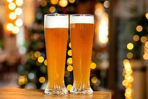 Two beer mugs with bokeh background photo