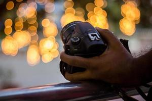 DSLR Camera on Bokeh Background Black DSLR Camera With Bokeh Lights Photo and Camera City Lights Bokeh