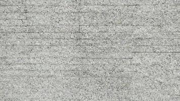 El fondo de textura de patrón de azulejos de grava gris foto