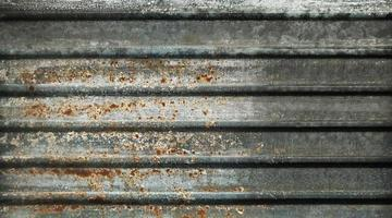 Old rusty zinc wall texture and background photo