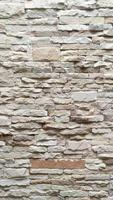 The white stone wall pattern texture background photo