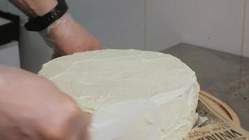 Chef Layers Frosting on a Cake video