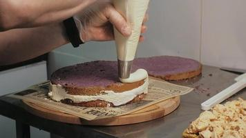 Cake Layers Being Frosted video