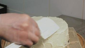 Baker Frosts a Cake video