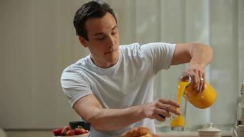Man having breakfast and looking at newspaper video