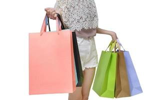 Attractive shopper woman holding shopping bags isolated on white background photo