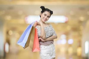 Attractive shopper woman holding shopping bags photo