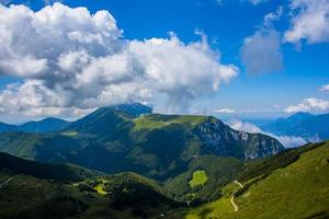 Clouds above green mountains photo