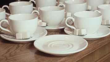 many empty white clean tea cups video