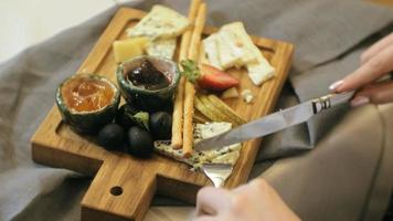 close up shooting  delicious cheese platter with sauces fruits and berries video