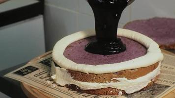 A Chef Pours a Berry Filling on Top of Cake video