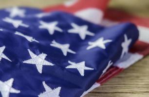 American flag on wood background photo