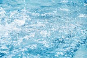 Water splash in swimming pool summer background photo