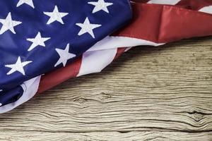 American flag on wood background with copy space photo