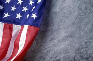 American flag on cement background with copy space photo