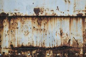 óxido en el fondo de textura de pared de metal antiguo foto