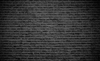 Black brick wall texture background photo