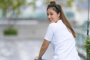 Woman in white t shirt and blue jeans photo