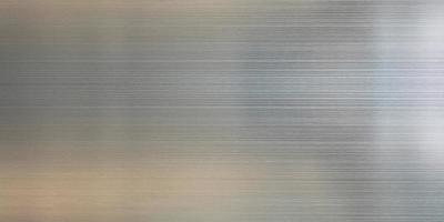 Metal texture bright gray background with reflection photo