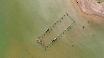 Aerial top view of Old temples in the water at Sangklaburi in Kanchanaburi province photo