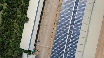 Aerial top view of the solar cells on the roof photo