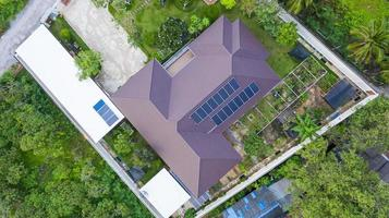 Aerial top view of the solar cells on the roof  Solar panels installed on house roof photo