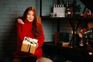 Asian girl with gift in her hands photo