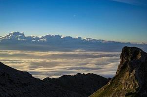 Clouds and mountains at twilight photo