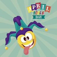 april fools day lettering with crazy emoji wearing joker hat vector