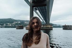 Portrait of a woman under a bridge photo