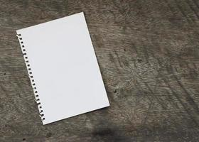 Book notes blank page on wooden background photo