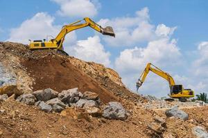 Excavator working outdoors under blue sky photo