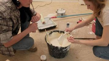 Two People Mixing Beige Paint video
