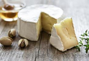 Camembert cheese with snacks photo