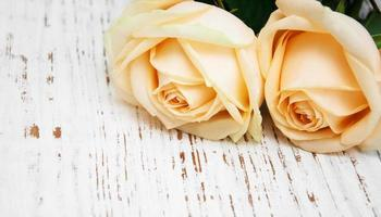 Roses on a wooden table photo