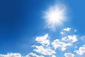 Shining sun against intense blue sky photo