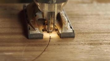 Carpenter Cuts Wood With a Jigsaw video