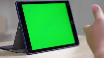 Working online conference using tablet networking green screen device Work from home explain to business team video