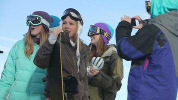 Group of young snowboarders on the slopes video