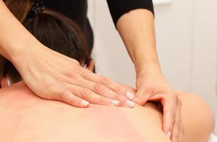 Body massage on the back and shoulders photo