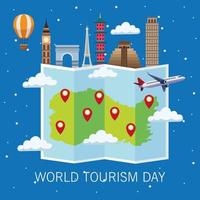 world tourism day lettering celebration with paper map and monuments vector