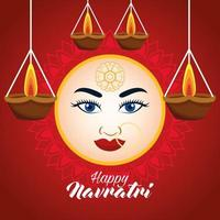 happy navratri celebration card with beautiful goddess face and candles hanging vector