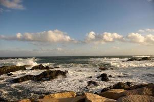 Cape Cod ocean hitting rocks photo