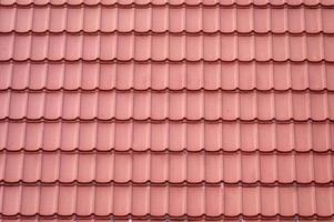 Roof tile seamless pattern covering on house photo