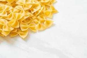 Dry uncooked farfalle pasta photo