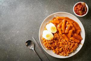 Ramen or Korean instant noodle and rice cake in spicy Korean sauce photo
