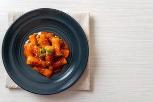 Korean rice cake stick in spicy sauce photo