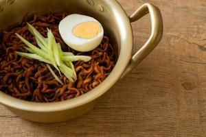 Korean instant noodle with black bean sauce topped with cucumber and boiled egg, Jjajangmyeon - Korean food style photo