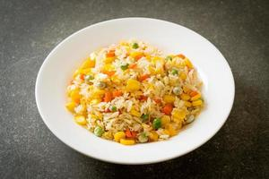 Homemade fried rice with mixed vegetables and egg photo